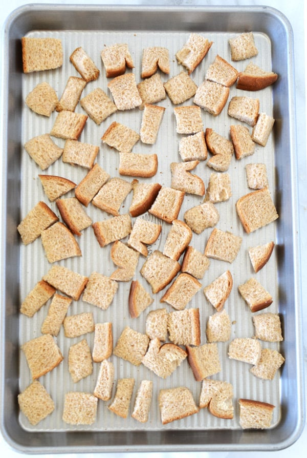 bread cubes on baking tray