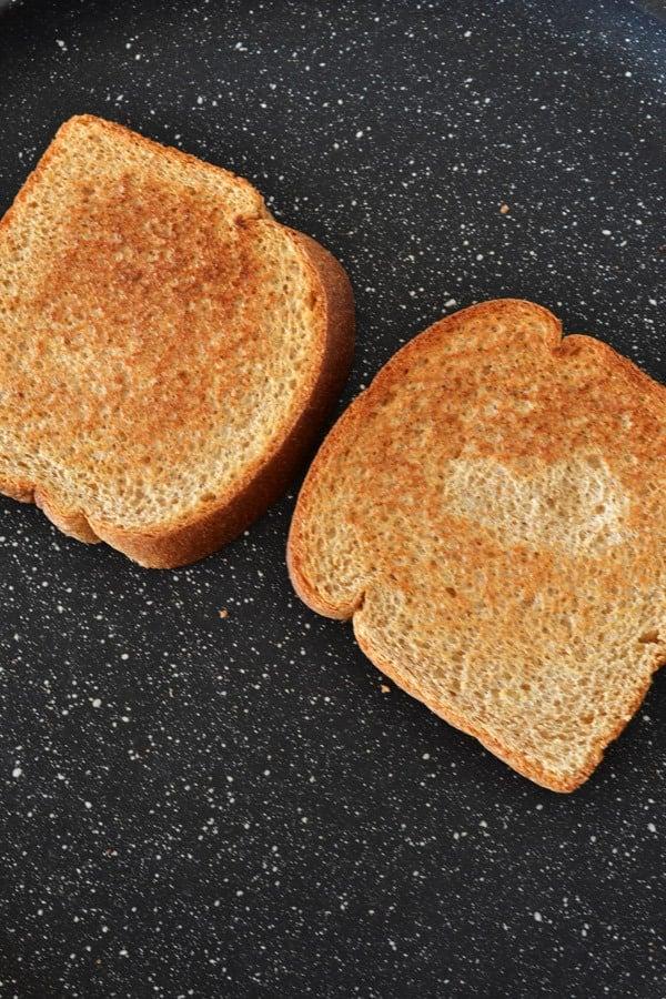 toasting bread in frying pan