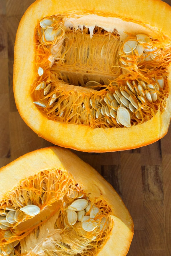 pumpkin cut open with seeds