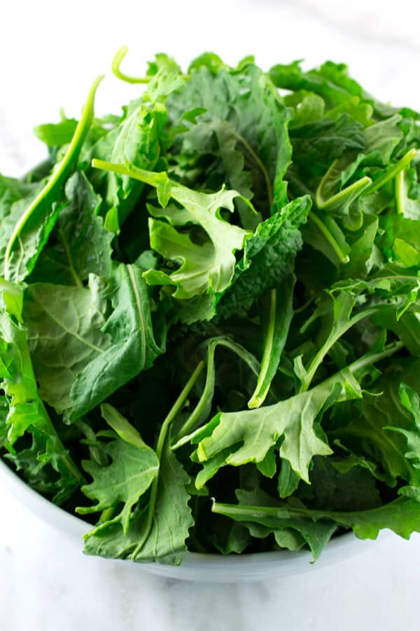 bowl of baby kale leaves
