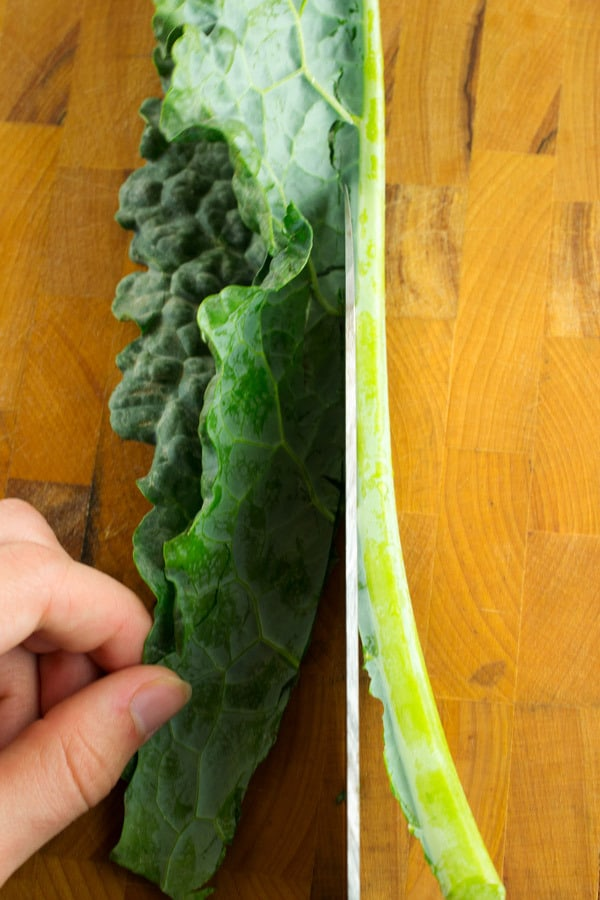 cutting the stalk off the kale