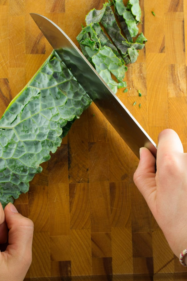 shredding the kale in ribbons