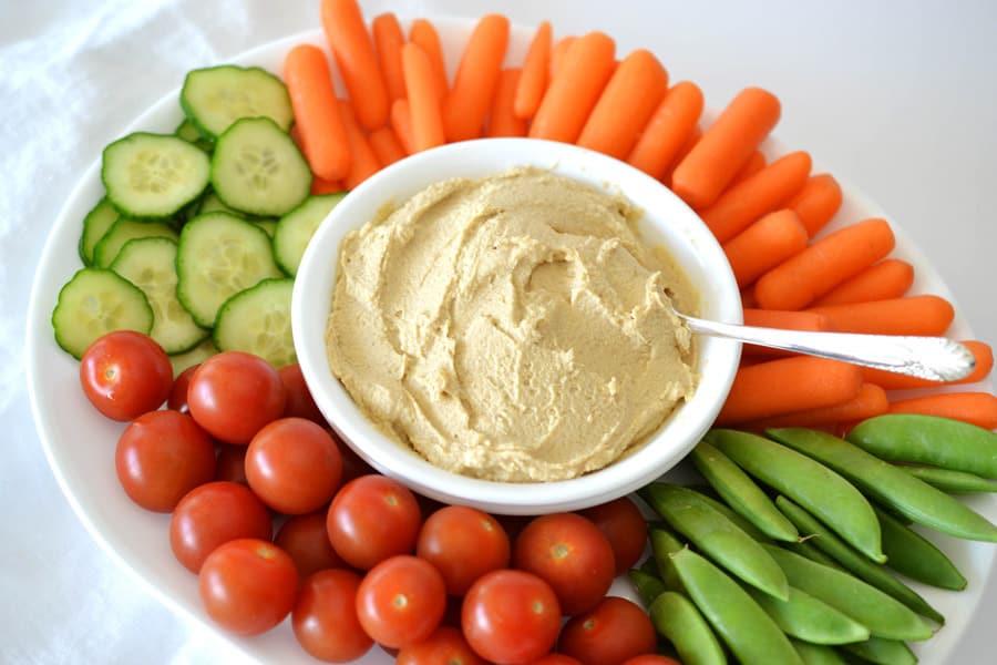 hummus in bowl on veggie tray