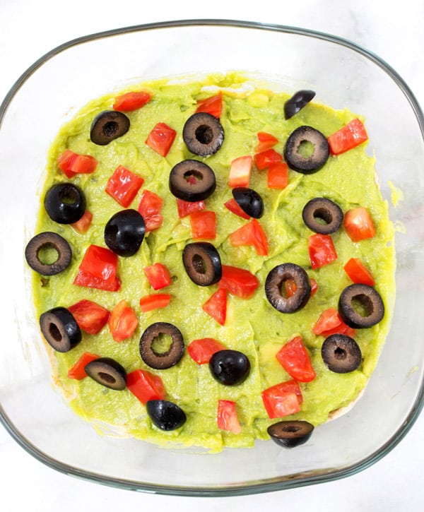 making 7 layer dip olive layer