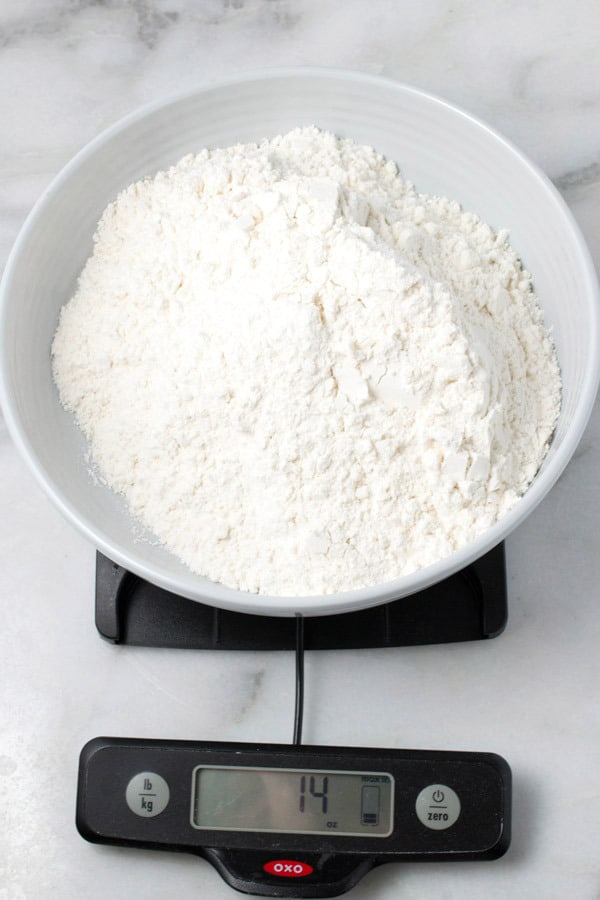 weighing flour for snickerdoodle cookies