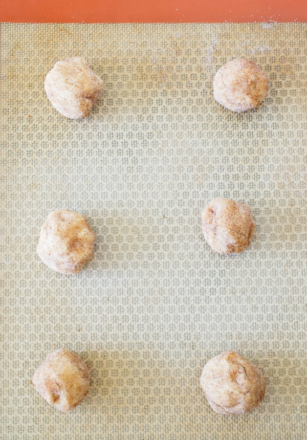 pumpkin snickerdoodle dough balls on silicone mat