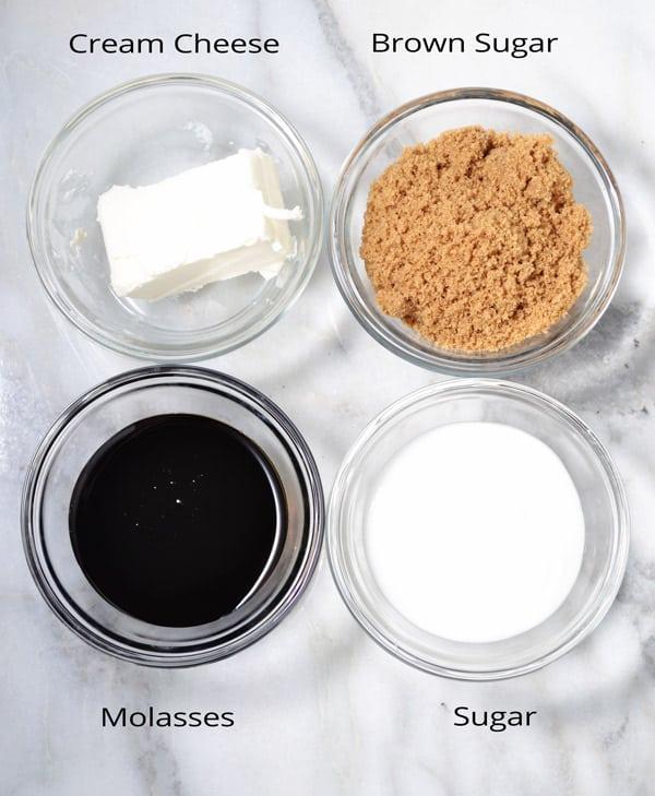 4 bowls of cream cheese, brown sugar, molasses, and white sugar