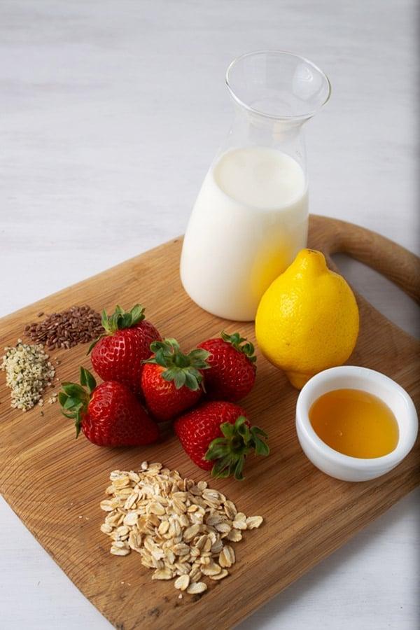 strawberries, lemon, milk, honey, oats