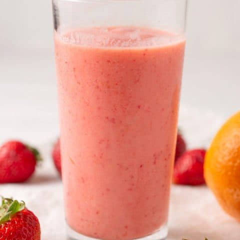 glass of cara cara strawberry smoothie with yogurt