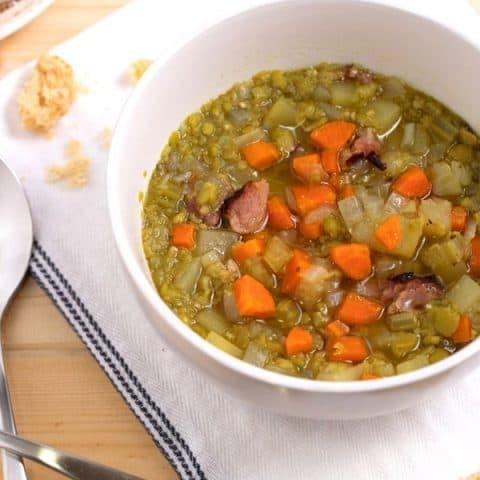 bowl of split pea soup with ham bone