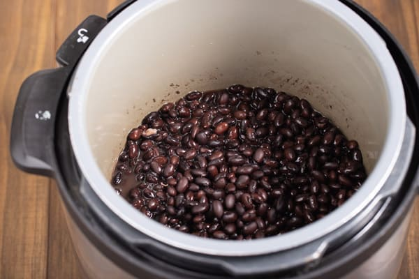 black beans cooking in a pressure cooker