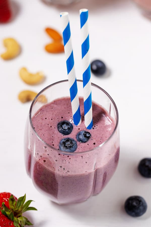 glass of blueberry strawberry banana smoothie