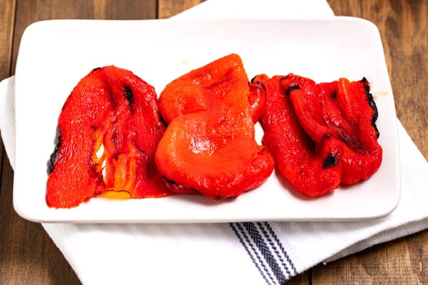 roasted red peppers skinned and on a plate