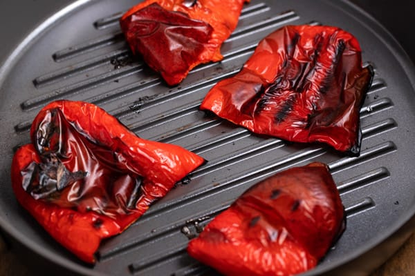 red peppers on a grill pan after being roasted
