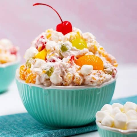 big bowl of ambrosia salad and a small bowl of mini marshmallows