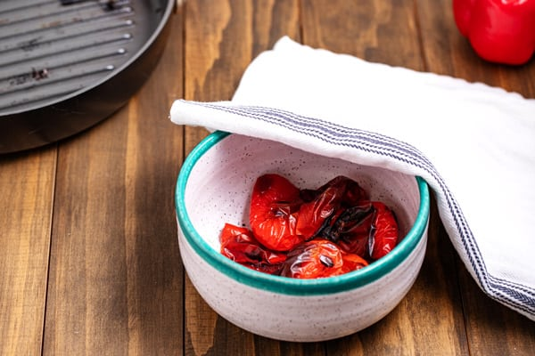 roasted peppers steaming in a bowl