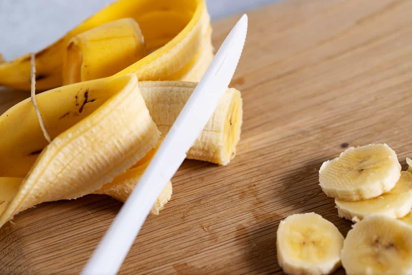 slicing banana with plastic knife
