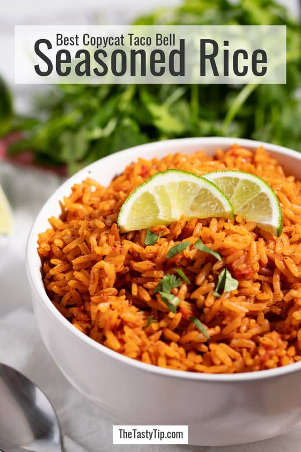 bowl of copycat Taco Bell seasoned rice with lime wedges