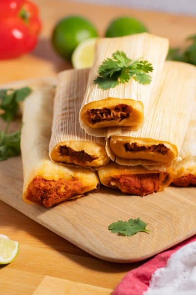 stacked tamales on cutting board