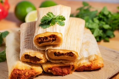 stack of tamales with cilantro