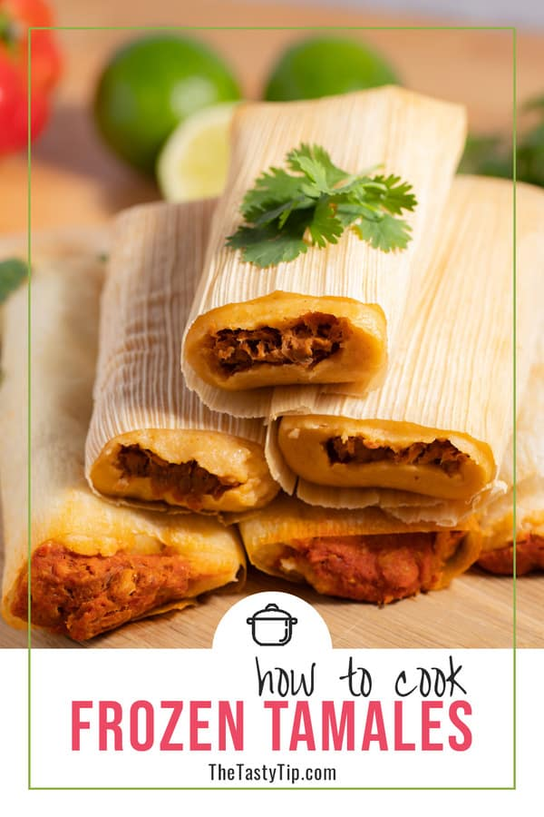 pile of cooked tamales with lime and red bell pepper in background