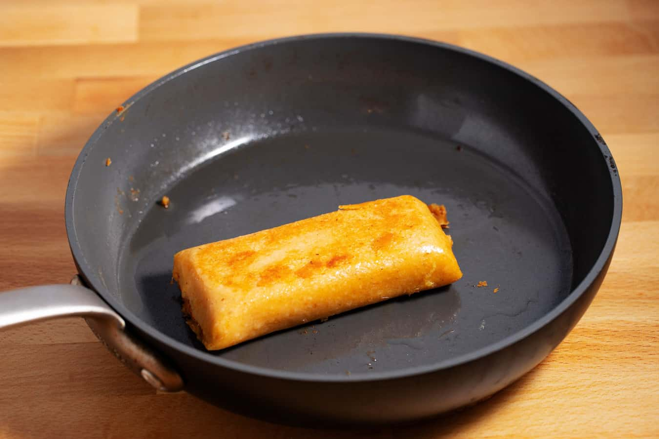 cooked tamale in skillet