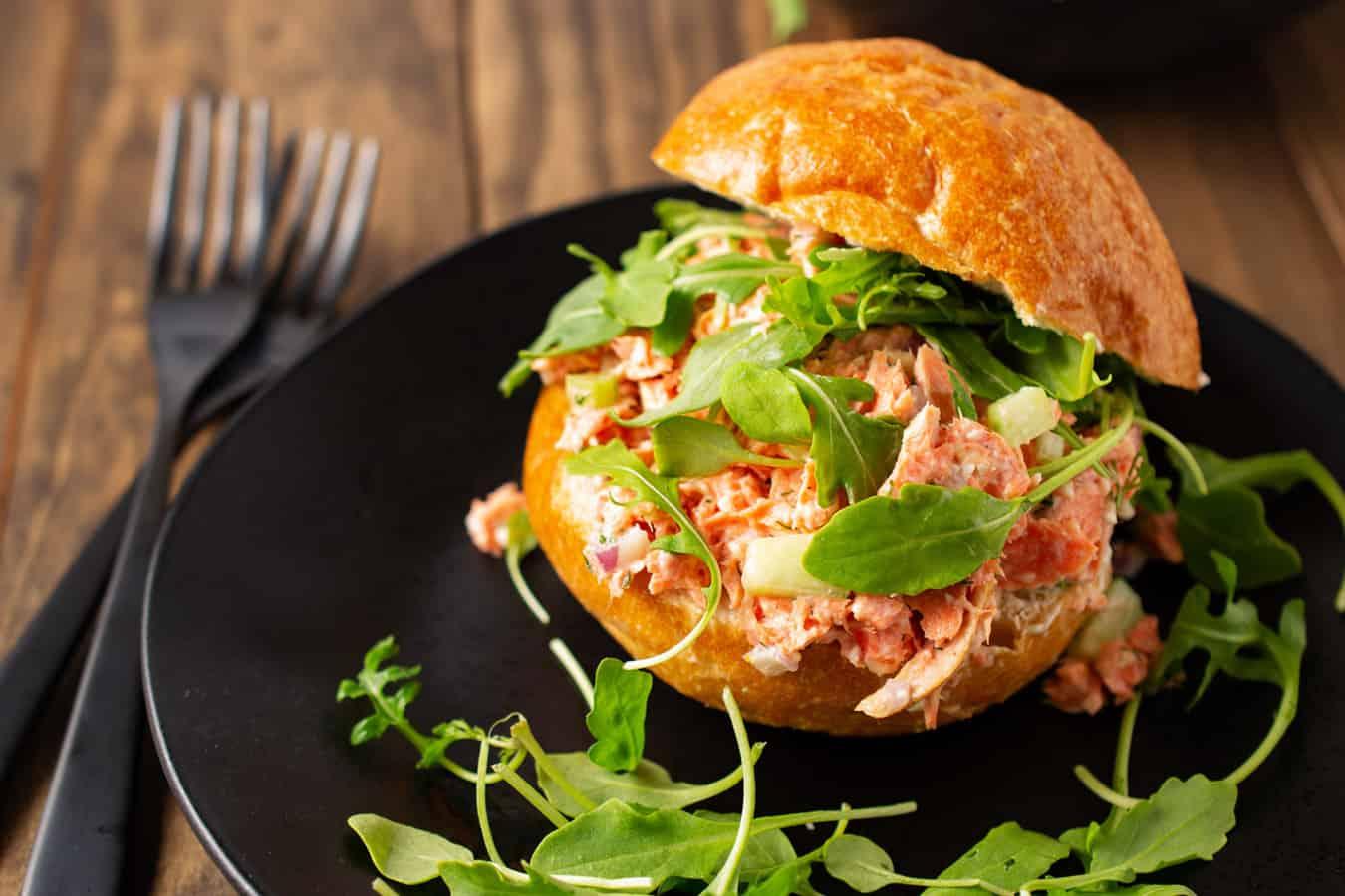 salmon salad sandich on plate