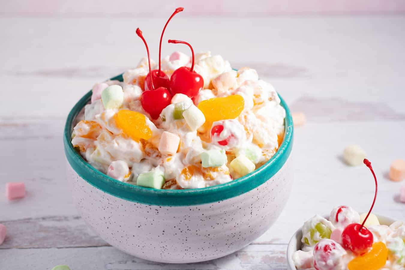 small and large bowls of ambrosia salad