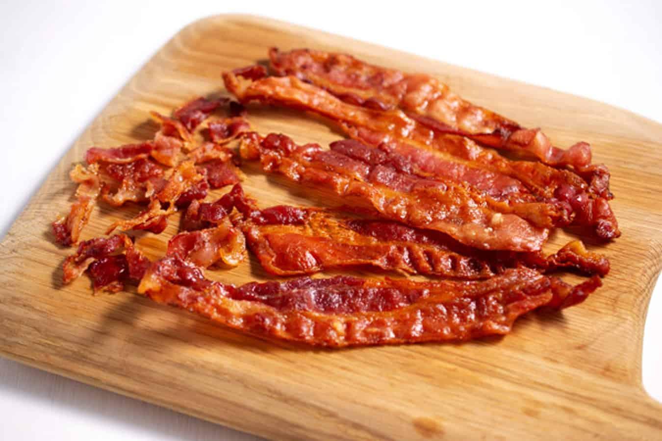 crispy bacon on cutting board
