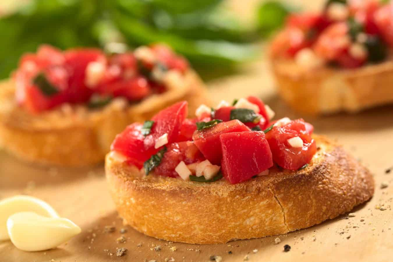 bruschetta with diced tomatoes, basil, and mozarella