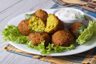 plate of falafel with sauce
