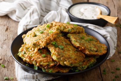 plate of fritters with dipping sauce