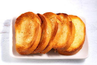 plate with 5 slices of garlic bread
