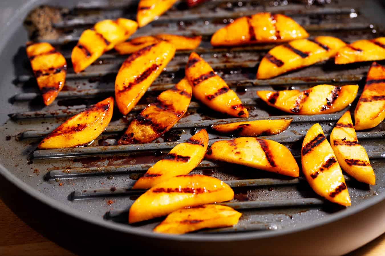 pan of grilled peach slices