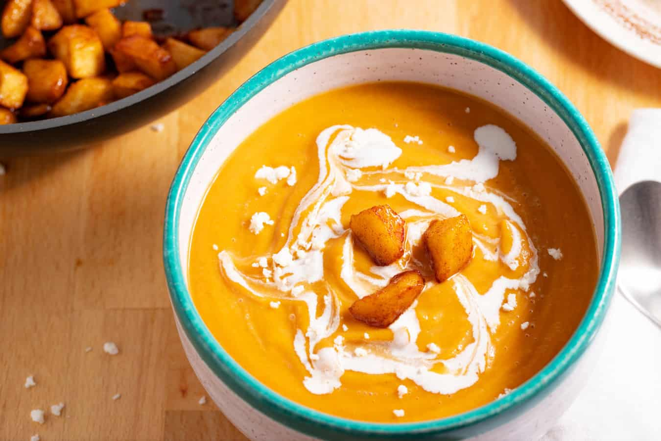 bowl of butternut squash soup with roasted apples