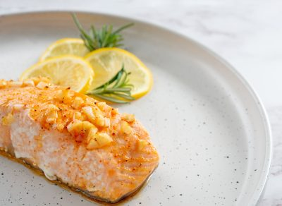 grilled salmon on plate with lemon slices
