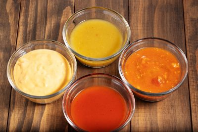 bowls of enchilada sauce, ranchero sauce, and queso