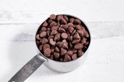 measuring cup of chocolate morsels