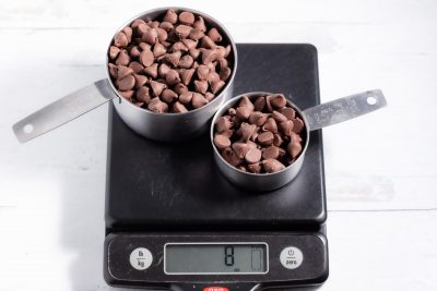 1 1/3 cups of chocolate chips on a kitchen scale