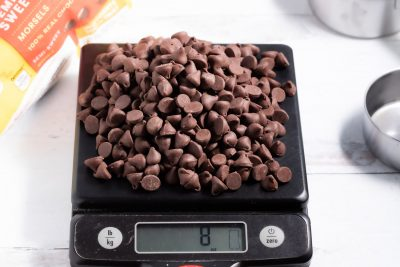 8 oz of chocolate chips on a kitchen scale