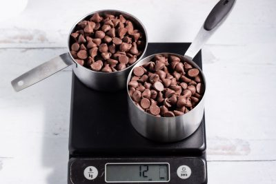 2 cups of chocolate chips on a kitchen scale showing 12 oz