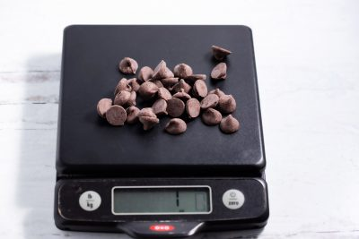 1 ounce of chocolate chips on a kitchen scale