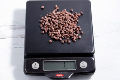 1 ounce of mini chocolate chips on a kitchen scale