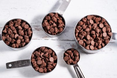 1 cup, 1/2 cup, 1/3 cup, 1/4 cup, and 1 tablespoon filled with chocolate chip morsels