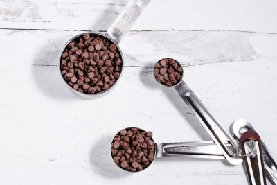 measuring cup and measuring spoons with mini chocolate chips