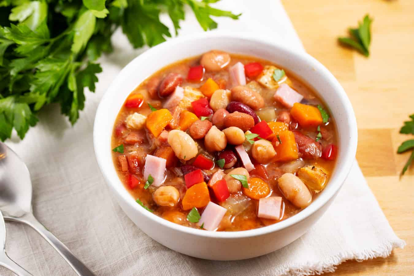 single bowl of 15 bean soup with spoons