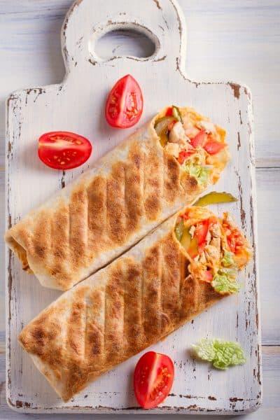 2 burritos on a cutting board
