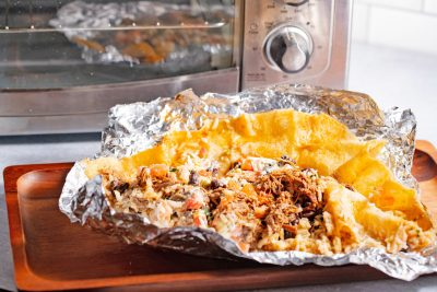 unrolled burrito ready to go in the toaster oven to reheat