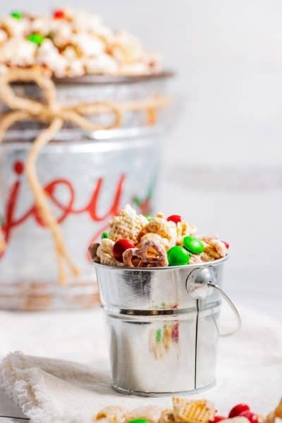Christmas chex mix in a serving pail